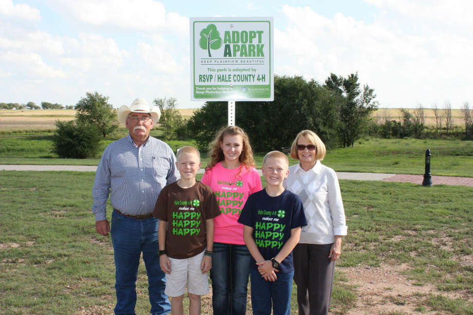 Courtesy PhotoAdvertising the newly launched Adopt a Park program are Parks Superintendent Rusty Reese (left), 4-H Club members Colton Scott, Samantha Scott and Colby Scott and Linda Shipp of RSVP. The two groups have adopted Regional Running Water Draw Hike & Bike Trail.