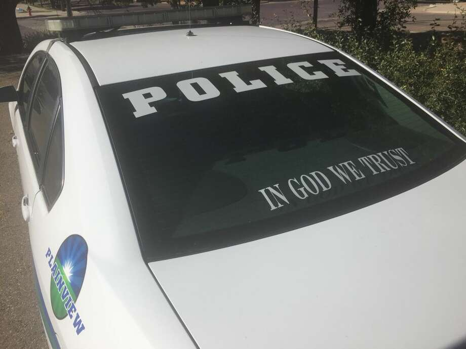 """Some Plainview police vehicles are now displaying new """"In God We Trust"""" decals after an official statement by Texas Attorney General Ken Paxton. Photo: Homer Marquez/Plainview Herald"""