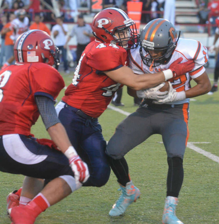 Plainview linebacker Trenton Jones (44) locks up a Dumas ball carrier during last week's football game. The Bulldog defense has improved throughout the year and will look for another strong effort this week when they host Hereford Friday at 7:30 p.m. Photo: Skip Leon/Plainview Herald