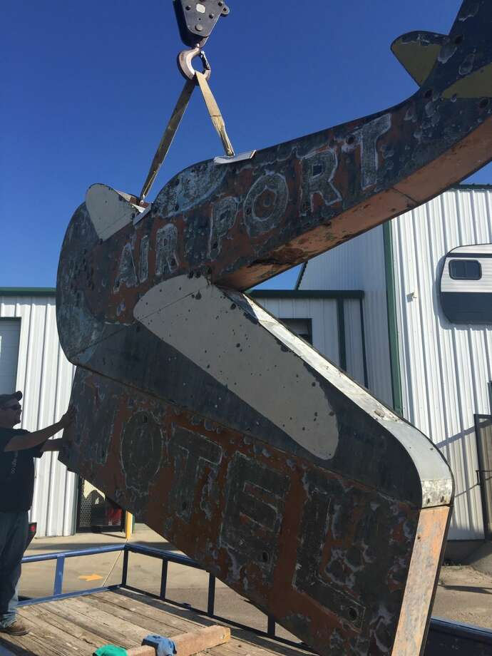 The new owner of Plainview's Airport Motel sign, Trent Sisemore, loads up the sign which will be placed at the RV Museum in Amarillo.