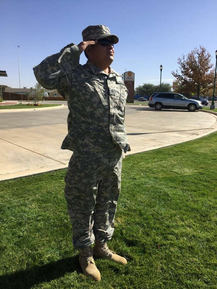 Retired Army Staff Sargent David Vasquez stands at full-attention for several hours in tribute for military veterans. Photo: Homer Marquez/Plainview Herald