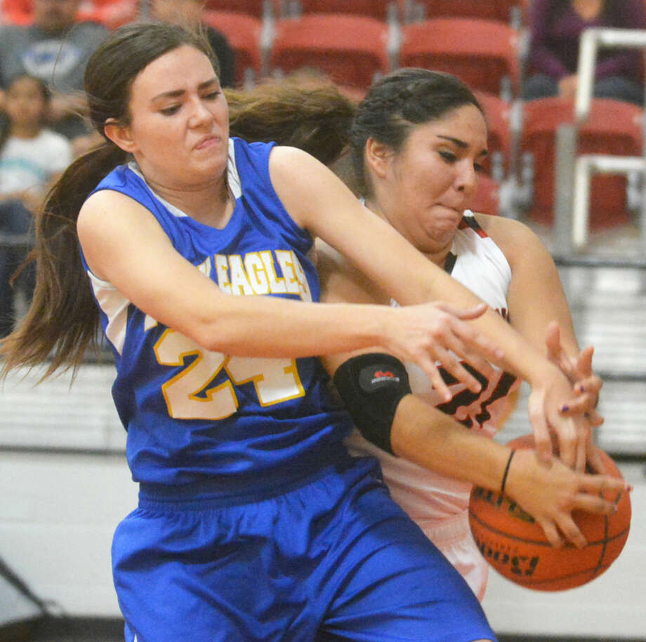 Plainview Christian Academy's Abbey Maresca (left) and Lockney's Briana Hernandez (right) battle for the ball during the opening game of the season for both teams Tuesday night. Photo: Skip Leon/Plainview Herald