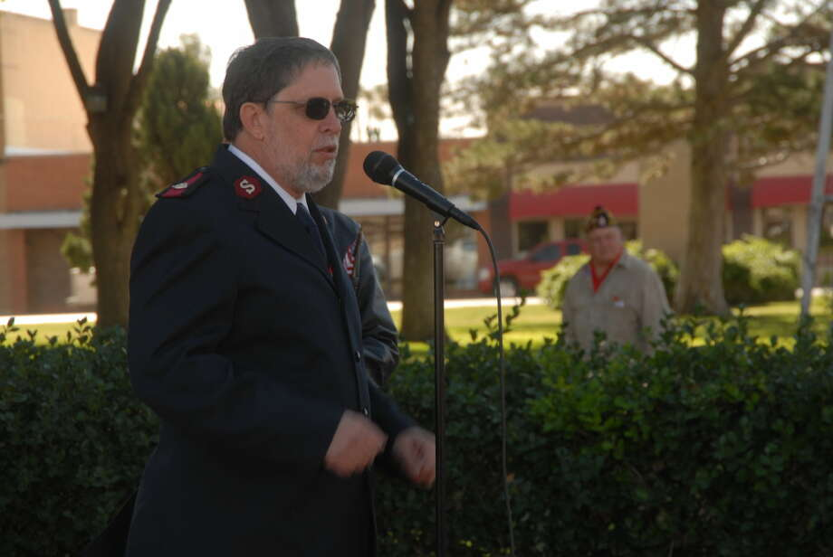 Maj. David Hodge announces the start of the 2015 Salvation Army Red Kettle Campaign during a special Veterans Day ceremony Wednesday at the courthouse. Photo: Homer Marquez/Plainview Herald