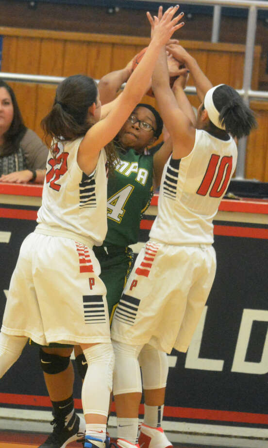 Plainview's Amela Dizdarevic (32) and Brittany Rincon (10) pressure a Pampa player during the Lady Bulldogs' 67-7 rout of the Lady Harvesters Saturday. Photo: Skip Leon/Plainview Herald