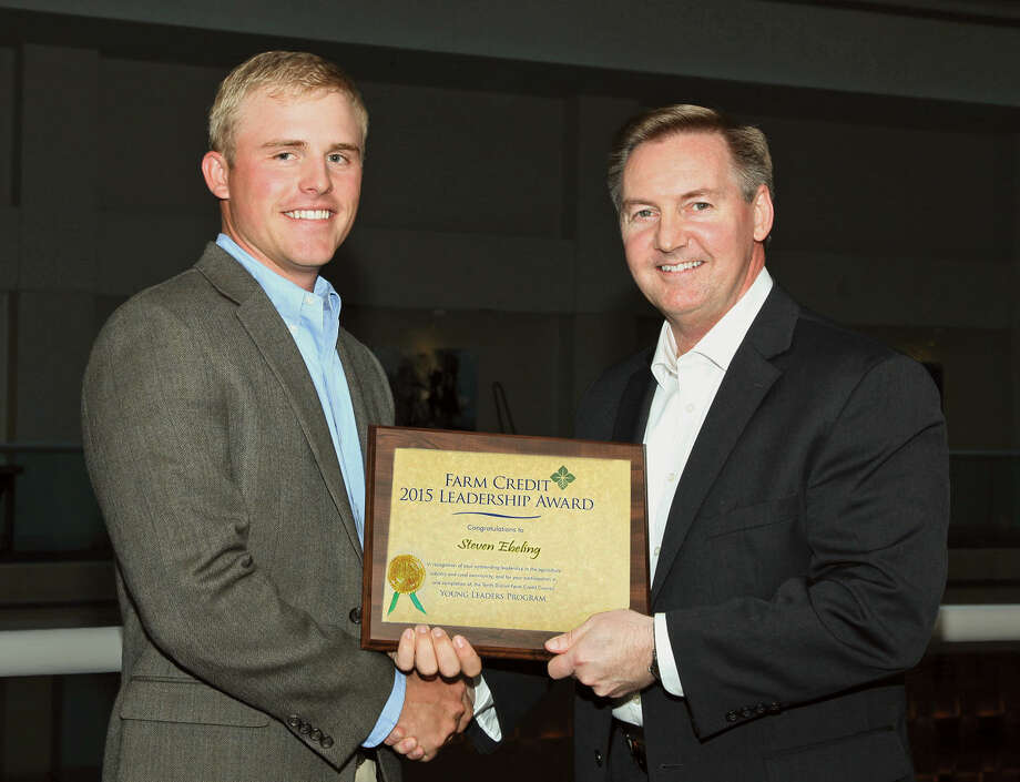 Steven Ebeling (left) of Plainview attended the 2015 Farm Credit Young Leaders Program on behalf of Plains Land Bank. He celebrated the completion of the program in Washington, D.C., with Stan Ray, Farm Credit Bank of Texas chief administrative officer and Tenth District Farm Credit Council president. Photo: Farm Credit Bank Of Texas