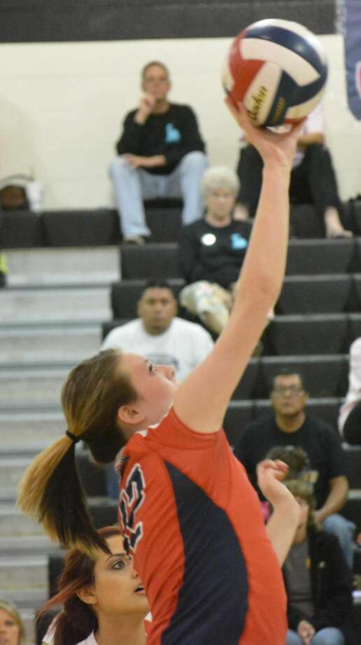 Plainview's Loren Johnson tips the ball over the net during a volleyball match at Lubbock High Friday. The Lady Bulldogs lost three close games to the Lady Westerners. Photo: Doug McDonough/Plainview Herald