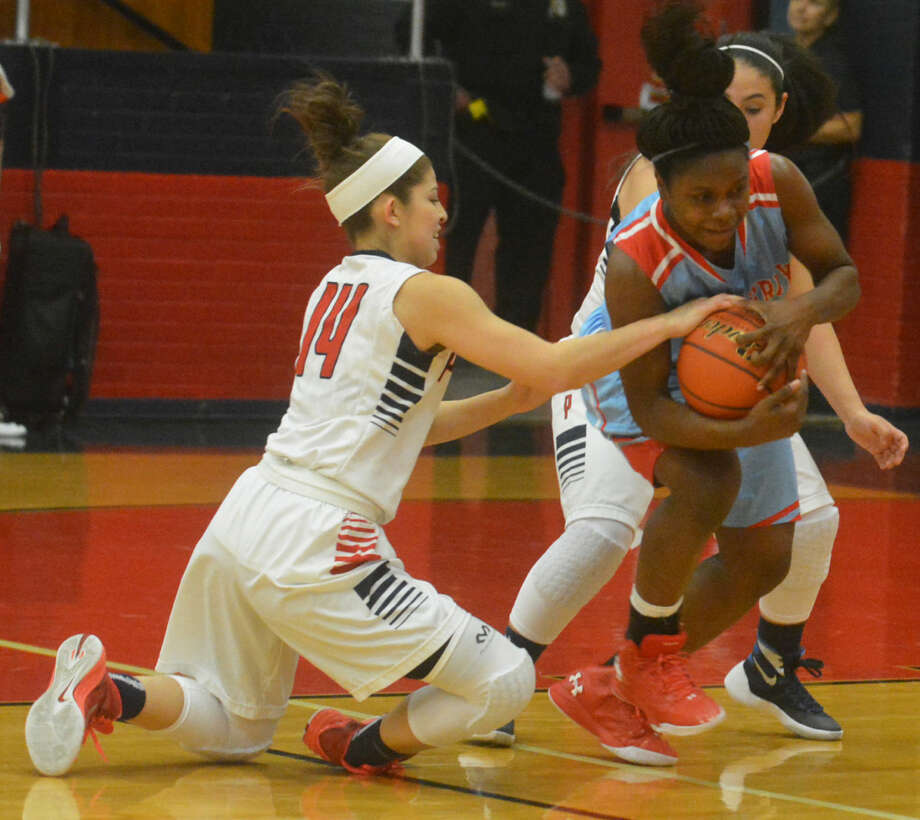 Plainview's Karly Sanchez (14) tries to rip the ball away from a Lubbock Monterey player as teammate Kaitlynn Sigala (background) also applies pressure during a girls basketball game Tuesday night. The Lady Bulldogs defeated Monterey 62-38 to raise their record to 2-1. Photo: Skip Leon/Plainview Herald