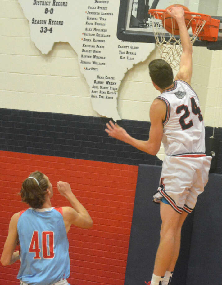Plainview's Bryson DeBerry goes above the rim to put down a dunk shot to open the fourth quarter of the Bulldogs' opening game of the season Friday night. Plainview defeated Lubbock Monterey, 85-74. Photo: Skip Leon/Plainview Herald