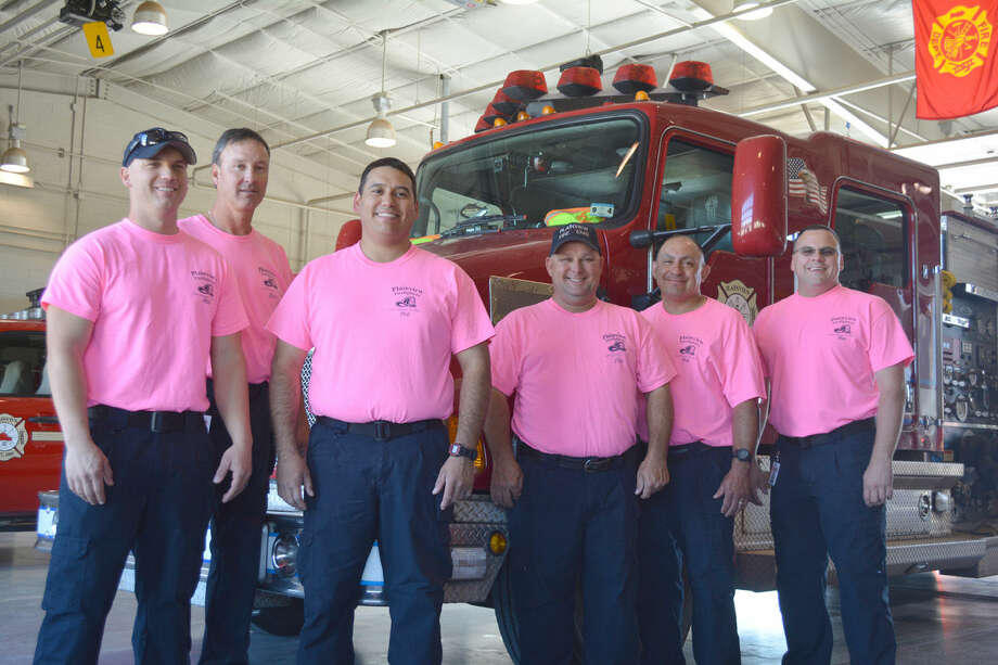 Pink Fire FightersDoug McDonough/Plainview HeraldIn recognition of Breast Cancer Awareness Month, members of the Plainview Fire Department/EMS are wearing special pink T-shirts throughout October. Several members of the department have family members affected by the disease. Among those suited up in pink on Friday are Equipment Operator/Paramedic Scott Stapp (left), Equipment Operator Bruce Fowler, Equipment Operator Tony Ramirez, Equipment Operator/EMT-I Tim Miller, Firefighter Gilbert Nunez and Equipment Operator/Paramedic Everett Bishop.