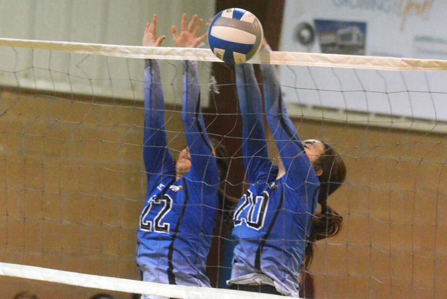 Plainview Christian Academy seniors Savannah Guzman, left, and Abbey Maresca go up for a block during the volleyball season. Both players were named to the all-district first team. Photo: Skip Leon/Plainview Herald