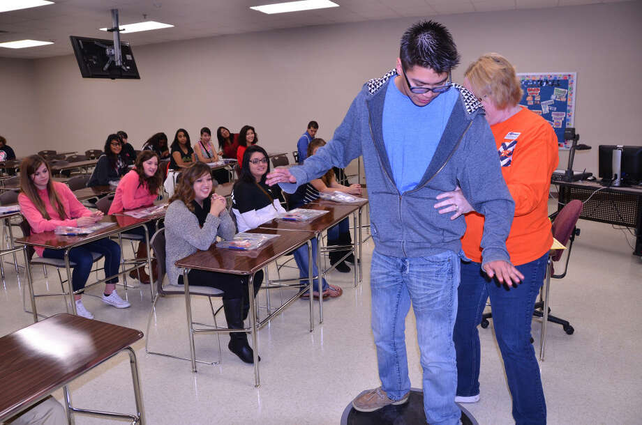 College Day at SPCWes Underwood/South Plains CollegePlainview High School senior Nickolas Garcia volunteers for a demonstration about balance with South Plains College's Jackie Underwood, program director of physical therapist assistant. More than 200 students from Plainview High participated in College Day. The students were given tours of multiple departments at SPC including Automotive, Commercial Music, Cosmetology, Criminal Justice, Fine Arts, Nursing, Physical Education, Physical Therapist Assistant, Science and Welding. Photo: WES UNDERWOOD