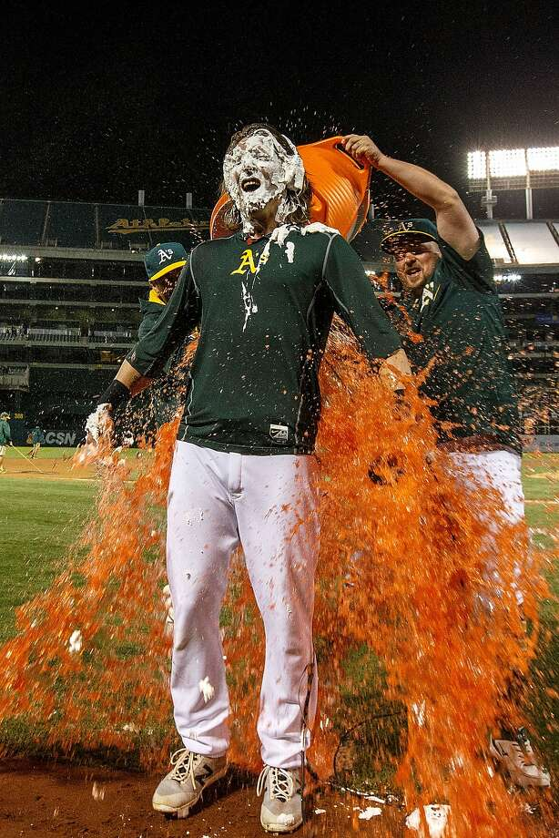 Billy Butler #16 of the Oakland Athletics pours Gatorade on Josh Reddick #22 after Reddick hit a walk off single against the Houston Astros during the tenth inning at the Oakland Coliseum on July 19, 2016 in Oakland, California. The Oakland Athletics defeated the Houston Astros 4-3 in 10 innings. Photo: Jason O. Watson, Getty Images