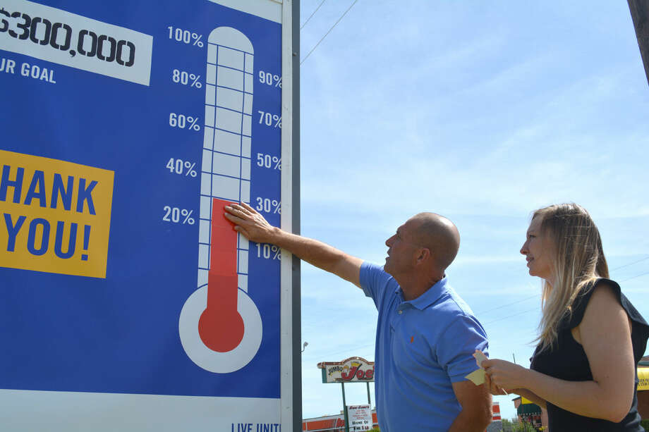Doug McDonough/Plainview HeraldPlainview Area United Way drive chairman Chris LeFevre and Executive Director Devon Melton update the campaign thermometer outside the Plainview/Hale County Economic Development Corporation/Plainview Chamber of Commerce to reflect that the drive currently stands at 30 percent toward a goal of $300,000. The next report meeting is set for noon Monday, Oct. 27, in the PHCEDC/Chamber meeting room. This year's effort will help support 11 partnering agencies.