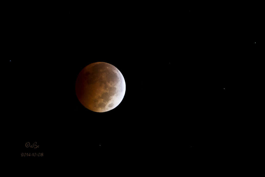 Connie Barnett/Courtesy PhotoA break in an overnight cloud cover offered an early-morning look at the lunar eclipse that pass over the area early Wednesday. Connie Barnett was able to capture the scene from her residence in southwest Briscoe County. Photo: Connie Barnett