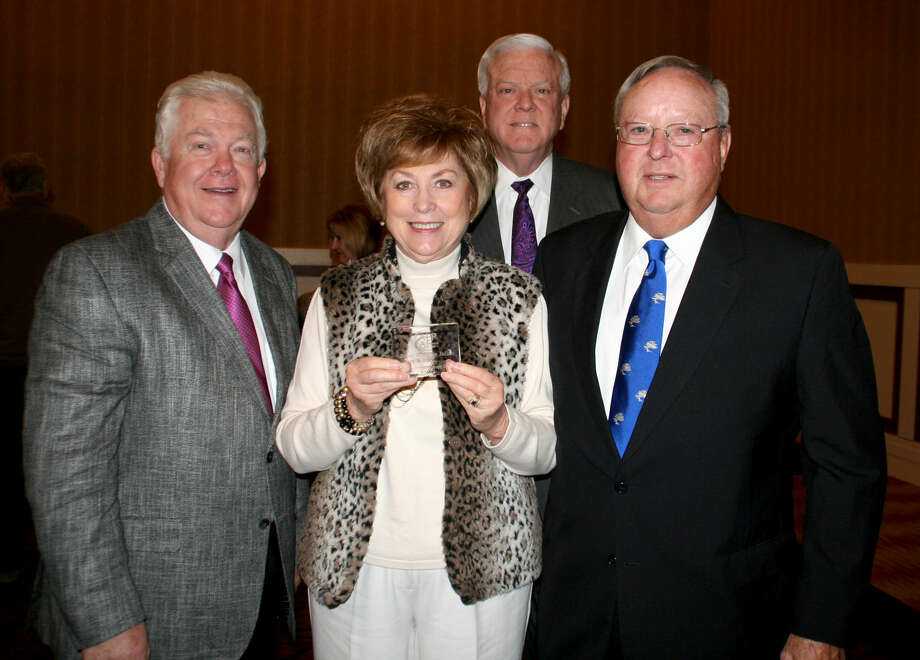 Teresa Young/Wayland Baptist UniversityDr. Paul Armes, (back), Wayland president, and Mike Melcher, executive director of advancement, flank donors Bruce and Jolene Julian of Perryton (front right) who were honored with the Spirit of Philanthropy Award at Thursday's luncheon. Photo: Unknown