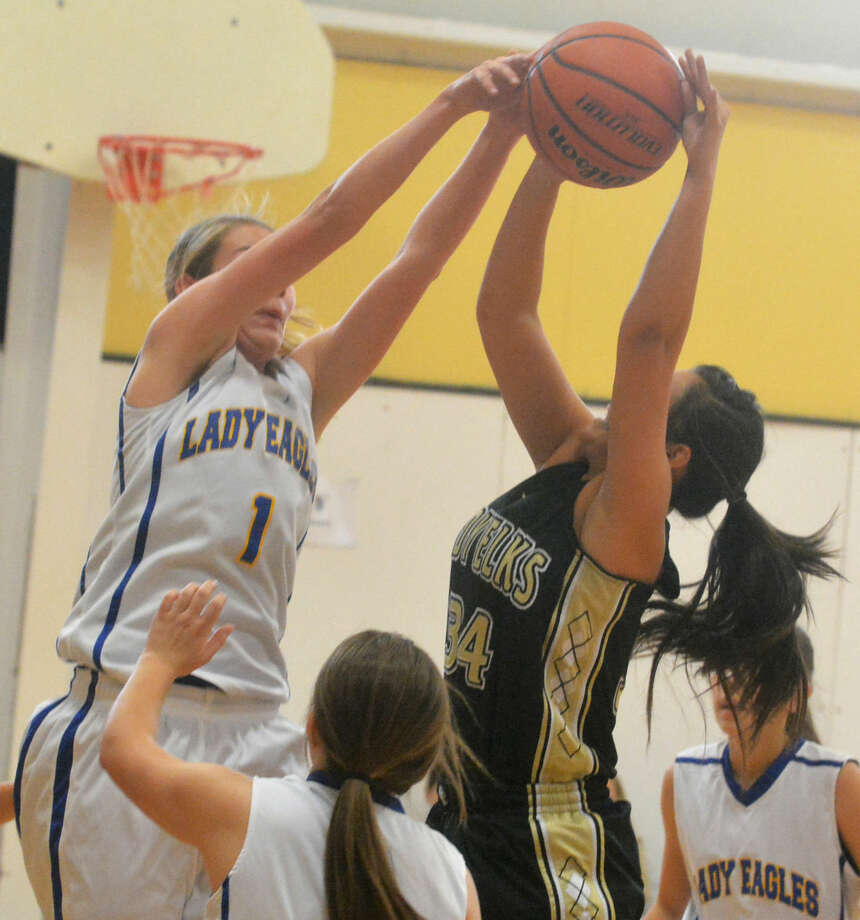 Plainview Christian Academy's Kylee Hill (1) blocks a shot by Cotton Center's Michaela Rivera (34) during a game at the Cotton Center Tournament Friday. Photo: Skip Leon/Plainview Herald