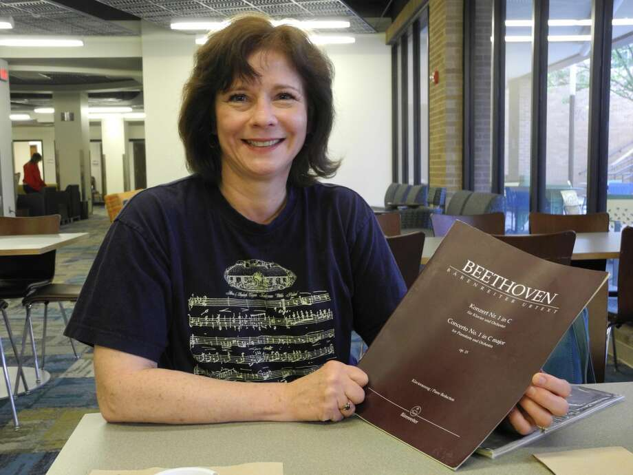 Dr. Melody Fried holds a copy of the piece she is performing, Concerto No. 1 in C Major by Ludwig Van Beethoven, at the Celebration of Life Symphony at 7:30 p.m. today in Harral Auditorium. The concert is free to all; a donation to the American Heart Association is appreciated. Photo: Gail M. Williams   Herald Lifestyles Editor
