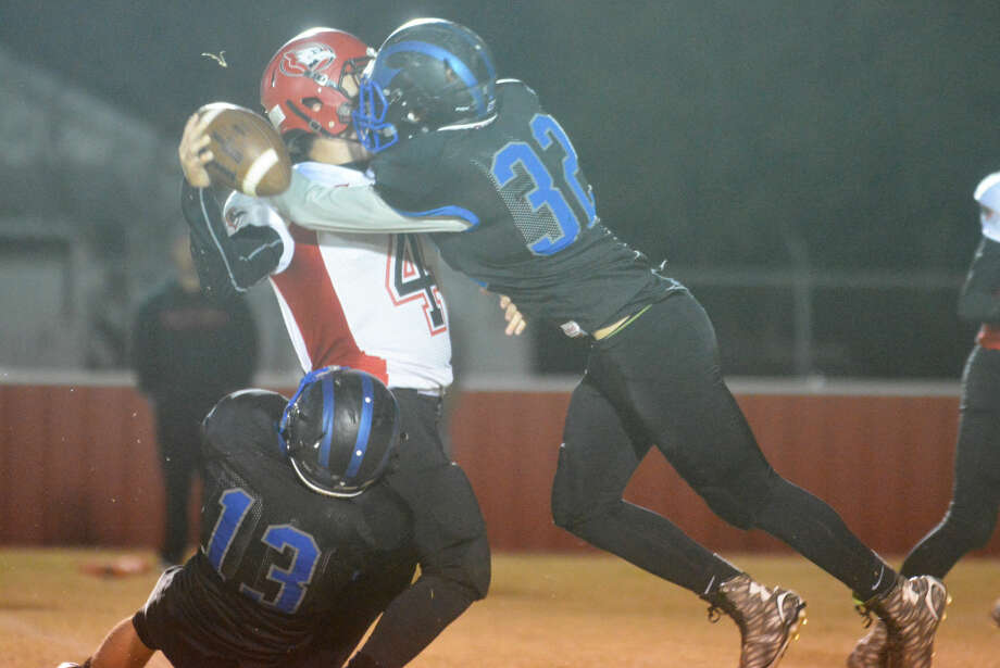 Plainview Christian Academy defenders Tyler Culwell (32) and Josh Snellgrove (13) combine to sack the Round Rock Concordia quarterback during a playoff game last week. The Eagles' season ended Friday night with a 60-15 loss to top-ranked Waco Live Oak Classical. Photo: Skip Leon/Plainview Herald