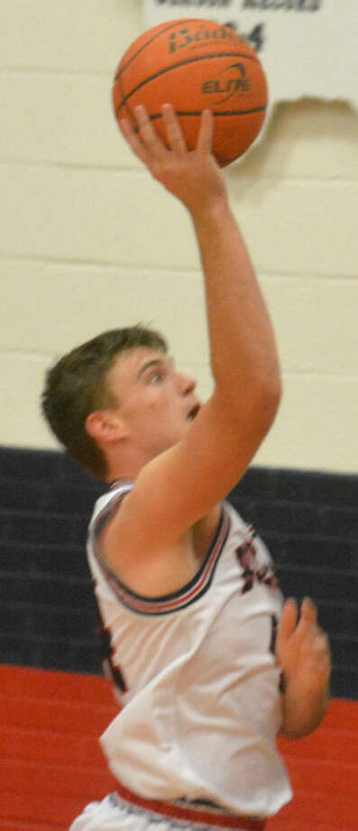 Plainview junior Beaux Bennett had a double-double with team-highs of 16 points and 11 rebounds to help the Bulldogs to a victory over Caprock. Photo: Skip Leon/Plainview Herald