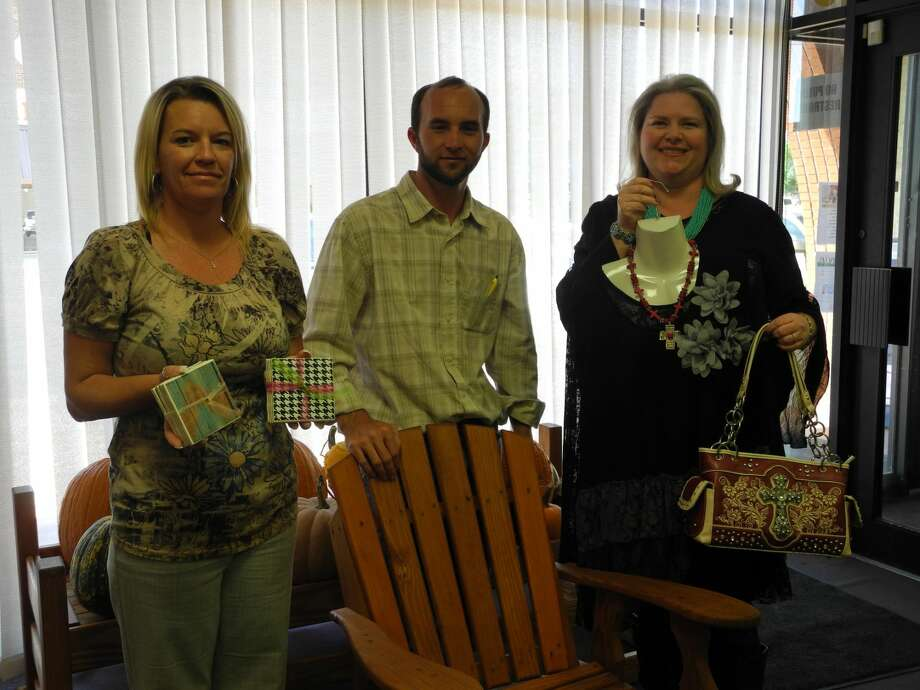 Exhibitors new to the 40th Running Water Draw Arts & Crafts Festival are Leslie Espinoza (left), Jeryl Wadel and Diana Farmer. Espinoza makes custom ceramic coasters, Wadel has a line of wood furniture, and Farmer offers clothing and accessories. Photo: Gail M. Williams | Plainview Herald