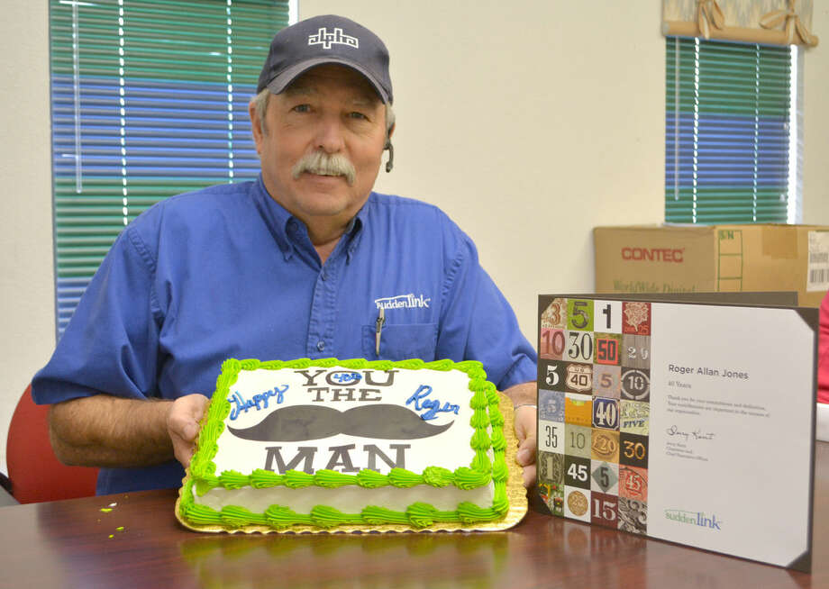 Roger Jones, a broadband technician for Suddenlink in Plainview, displays the cake and certificate he received at a luncheon Wednesday marking his 40th anniversary at the local office.