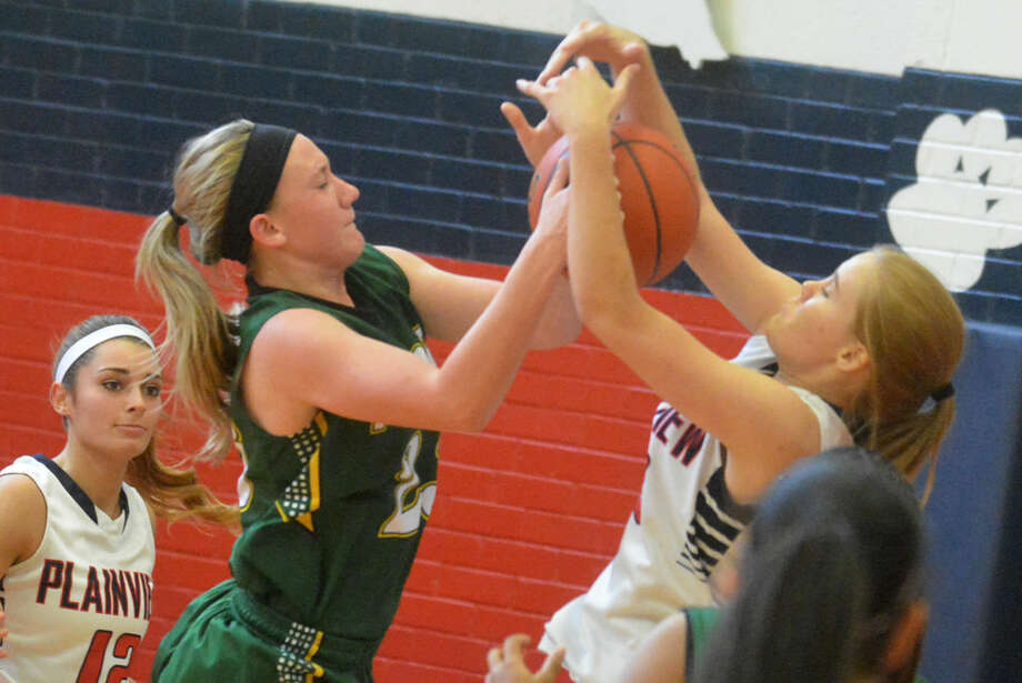 Plainview's Morgan Conley, right, battles with an opponent for a rebound during a game earlier this season. The Lady Bulldogs raised their record to 8-2 with a victory over Caprock earlier this week. Photo: Skip Leon/Plainview Herald