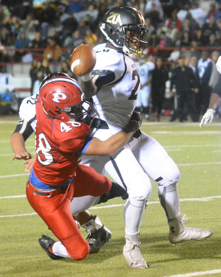 Plainview defensive end J'ryn Vela (48) sacks the Lubbock High quarterback during the final regular-season football game. Vela was part of a veteran defensive unit that played solidly throughout the year. Photo: Skip Leon/Plainview Herald