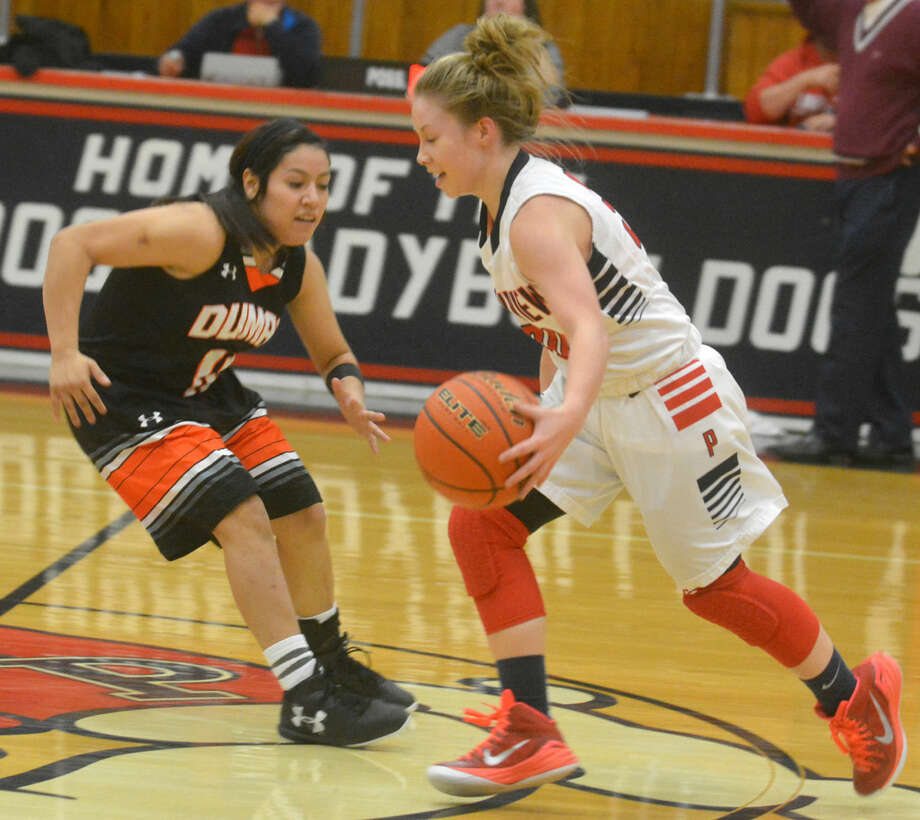 Plainview's Jaden Gonzales dribbles past a Dumas defender during a girls basketball game Tuesday night. Gonzales scored a game-high 22 points, including 12 during a pivotal fourth quarter and six in the final minute of play to lead the Lady Bulldogs to their ninth win in 11 games. Photo: Skip Leon/Plainview Herald