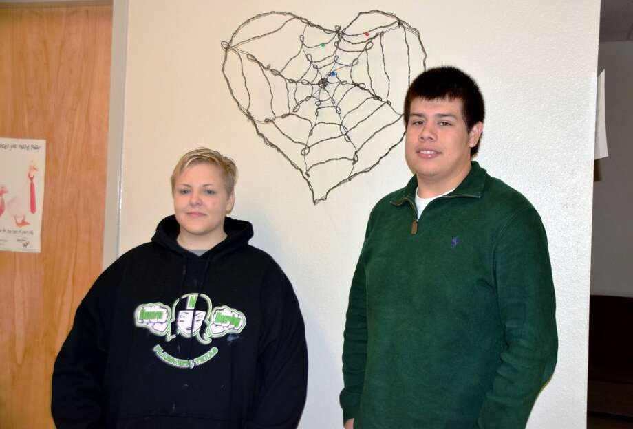 Jan Seago/Plainview ISDJessica Sanchez and Austin Balderas, Houston School Students of the Month for September, pose in front of a wire sculpture created by Sanchez. The pair was selected for the honor by the Houston School staff.