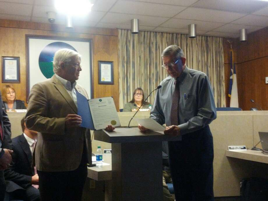 Mayor Wendell Dunlap declares World Polio Day for Oct. 24 and recognizes the Rotary Club, represented by Dr. Charles Starnes, for the work to fight against the disease. Photo: Homer Marquez/Plainview Herald