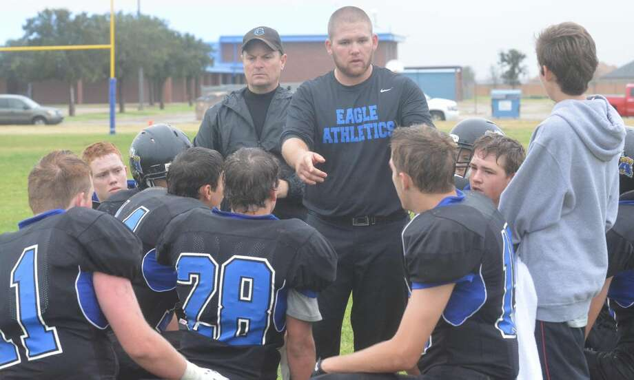 Plainview Christian Academy assistant football coach Lucas Hall talks with the team as head coach Chip Summers looks on during a game earlier this season. The Eagles are looking for a strong start in district when they host Christ the King at 4 p.m. Friday. Photo: Skip Leon/Plainview Herald