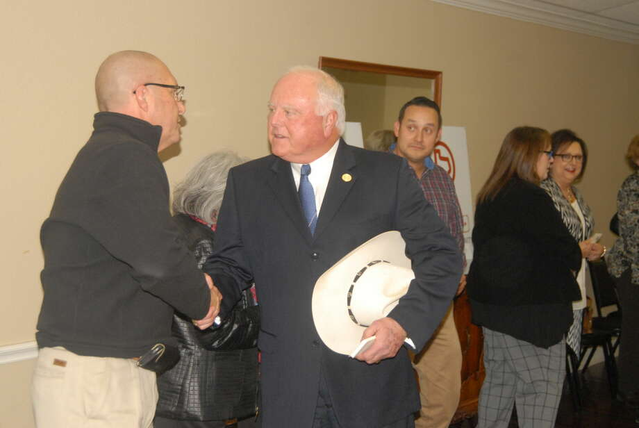 Texas Agriculture Commissioner Sid Miller shakes hands with Chris LeFevre and other locals during a visit Tuesday at the Hale County Senior Citizens Center. Photo: Homer Marquez/Plainview Herald
