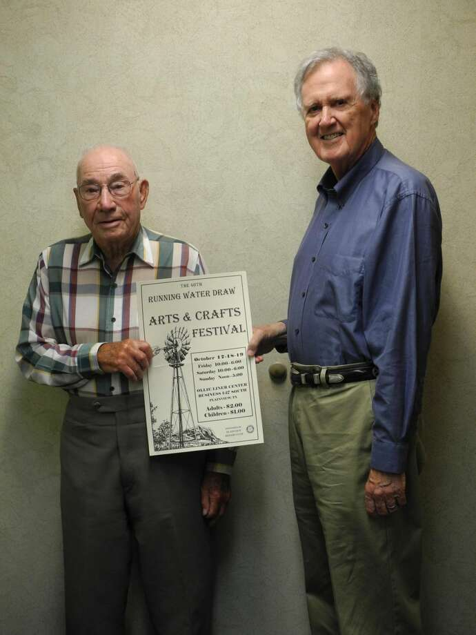 Elton Wilson and J.B. Roberts hold up a poster for the 40th Running Water Draw Arts & Crafts Festival, sponsored by Plainview Rotary Club. The two, both Rotarians, have been involved in the festival since its beginning in 1975. Photo: Gail M. Williams | Plainview Herald