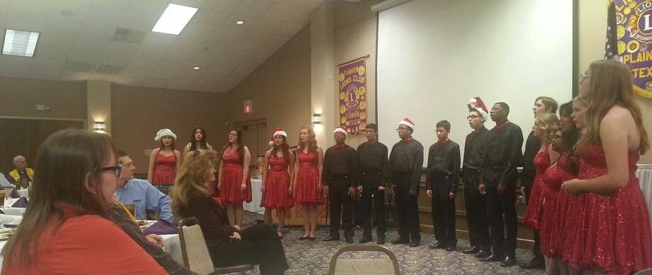 The Plainview Lion's Club hosted the annual joint meeting with the Plainview Rotary Club on Wednesday, Dec. 2. Rotarians Susan Blackerby and Leslie Schmidt enjoyed the performance of the Plainview Chamber Singers directed by Deborah Buford. Photo: Charles Starnes Plainview Rotary Club
