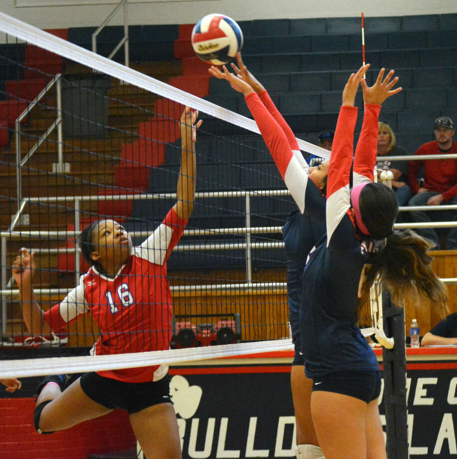 A Plainview blocker just gets her finger tips on the ball in a District 4-5A volleyball match against Abilene Cooper at the Dog House Friday afternoon. Photo: Doug McDonough/Plainview Herald