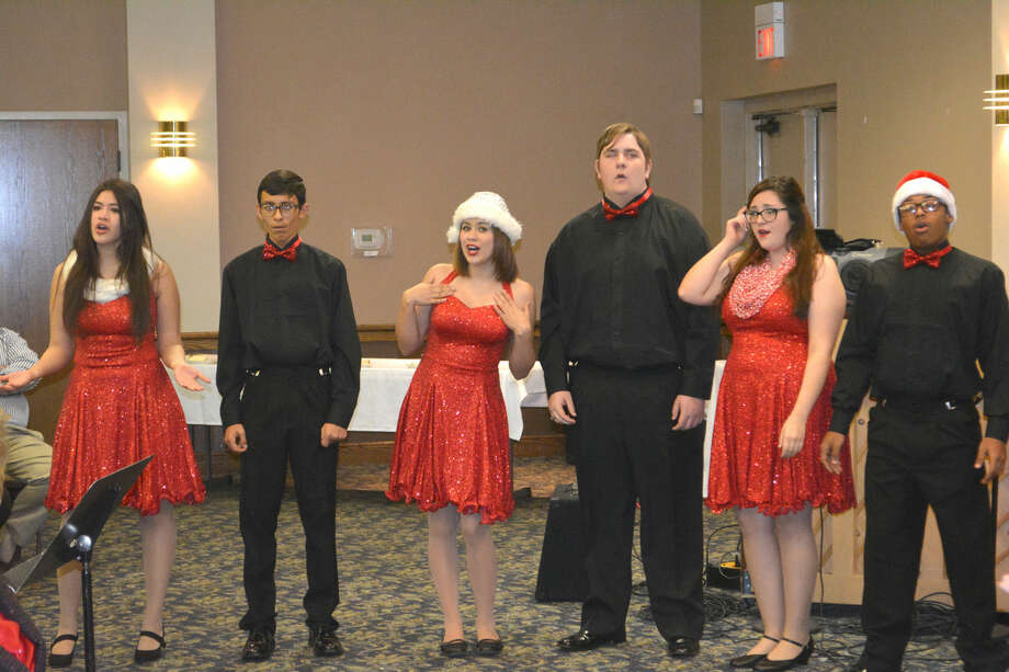 The Chamber Singers perform Wednesday during a joint meeting of the Plainview Lions and Plainview Rotary clubs. The elite vocal performance group from the PHS Choral Music Department, the Chamber Singers will be among groups featured Monday during the annual PHS Choir Christmas Concert.