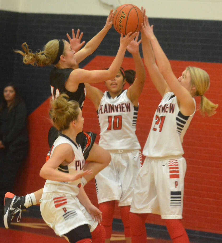 Plainview's Allie Bennett (24) blocks a shot by a Dumas player as teammates Brittany Rincon (10) and Jaden Gonzales (foreground) also defend during a game earlier this season. The Lady Bulldogs routed District 4-5A foe Abilene Cooper, 57-21, at the Levelland Tournament Friday. Photo: Skip Leon/Plainview Herald