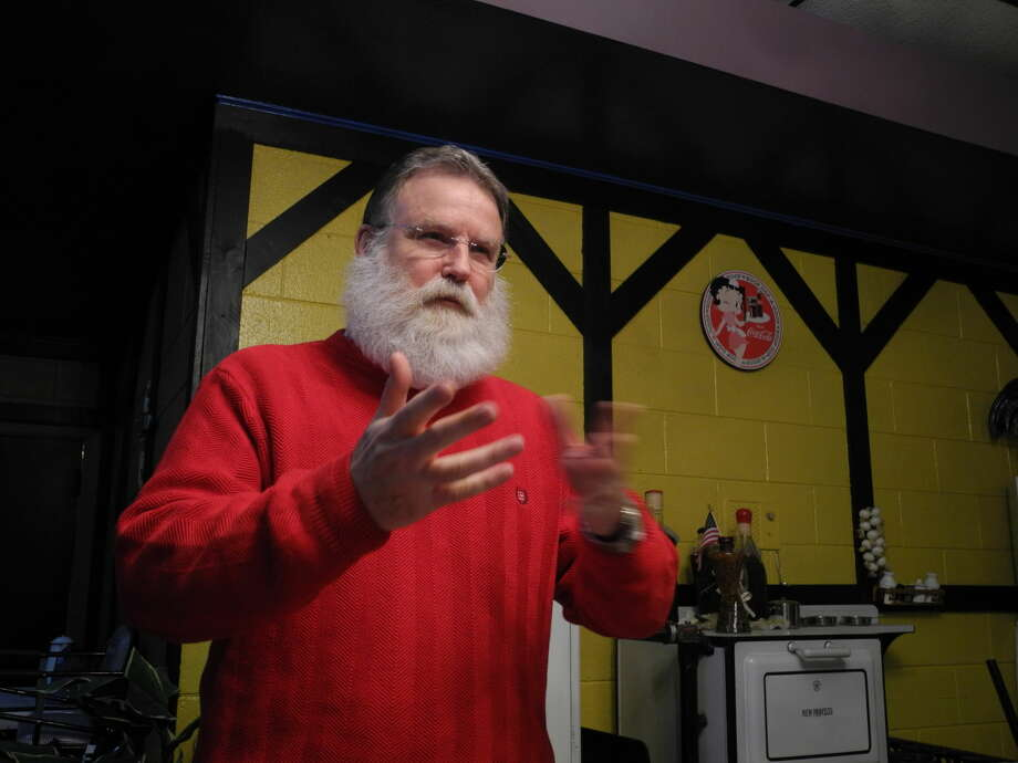 With his bushy beard and red sweater, Rodney Watson is often mistaken for Santa Claus even when he's not wearing his red suit. Watson reminisced about his 16 years in the role of Santa at the annual Hi-Plains Genealogy Society & Hale County Historical Commission joint meeting at Old Mexico last week.