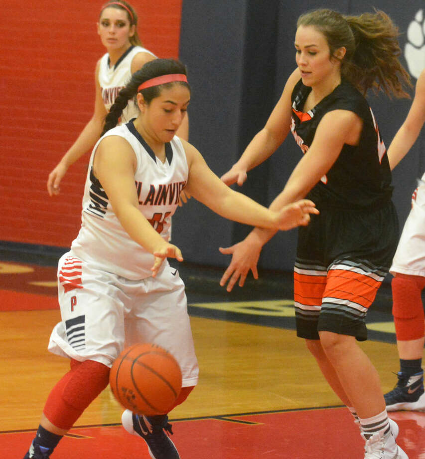 Plainview's Kaitlynn Sigala (left) steals the ball from a Dumas player during a game earlier this week. The Lady Bulldogs have won two of three games at the Levelland Tournament Thursday and Friday, including a 57-21 steamrolling of Abilene Cooper Friday afternoon. Photo: Skip Leon/Plainview Herald