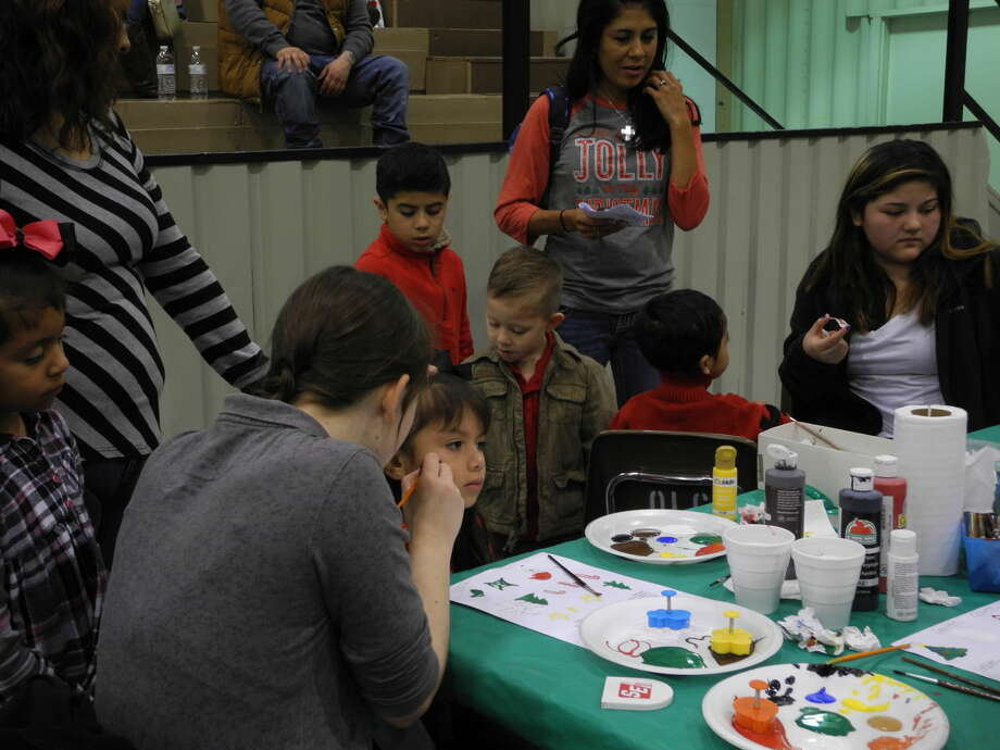 Face painting was one of the popular activity stations on Saturday at the annual Breakfast with Santa, hosted by Runningwater Draw RSVP and 4-H.