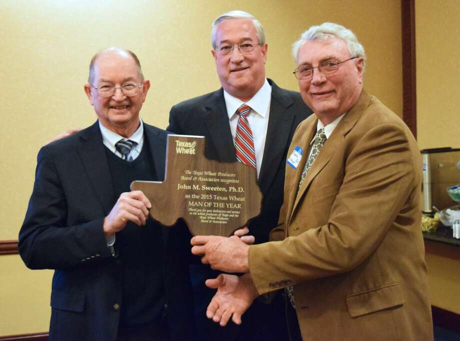 John M. Sweeten, Ph.D., resident director at the Texas A&M AgriLife Research Center in Amarillo, receives a plaque as the 2015 Wheat Man of the Year.