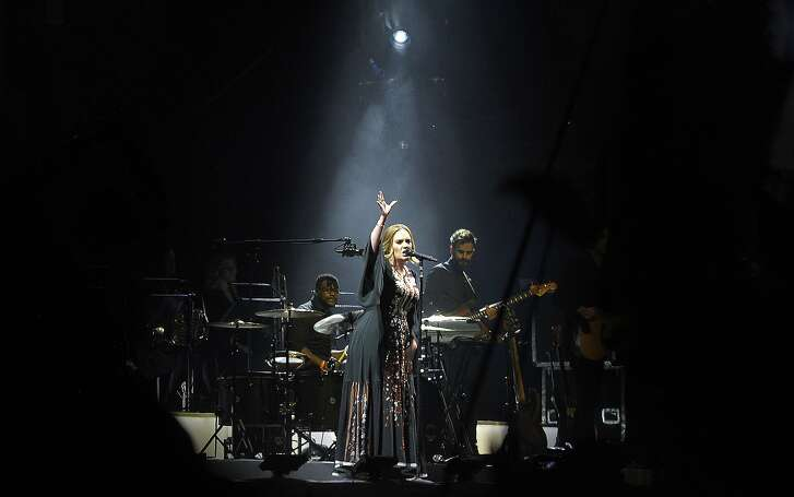 British artist Adele performs on the Pyramid Stage at the Glastonbury on day four of the Glastonbury Festival of Music and Performing Arts on Worthy Farm near the village of Pilton in Somerset, south-west England on June 24, 2016.   / AFP PHOTO / Andy BuchananANDY BUCHANAN/AFP/Getty Images