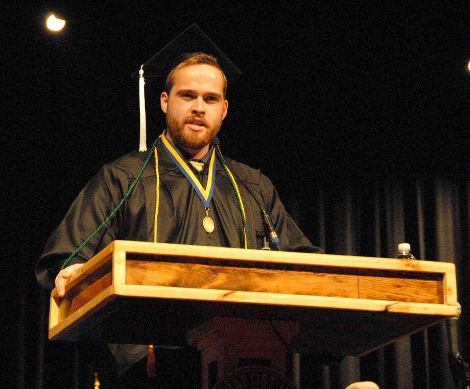 Tyler Moore, a business administration and religion major from Fritch, addresses his fellow graduates Saturday afternoon at Wayland December Commencement.