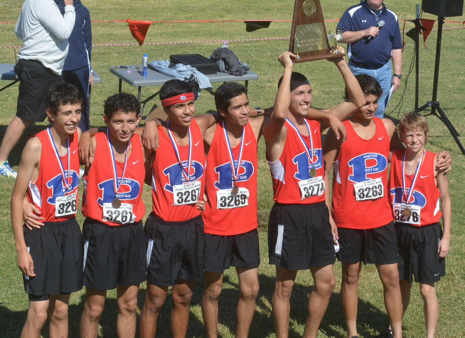 The Plainview boys cross country team poses with the District 4-5A championship plaque they earned Thursday. It was the second consecutive district title for the Bulldogs. Photo: Skip Leon/Plainview Herald