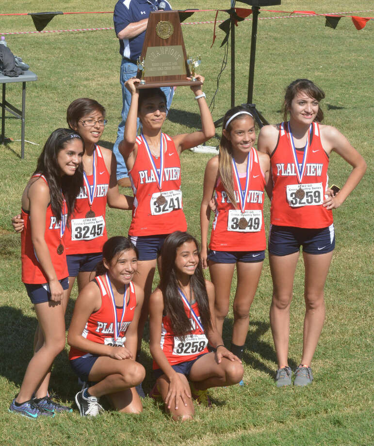 The Plainview girls cross country team poses with the District 4-5A championship plaque they earned at the district meet Thursday. The Lady Bulldogs were one of four team champions for Plainview. Photo: Skip Leon/Plainview Herald