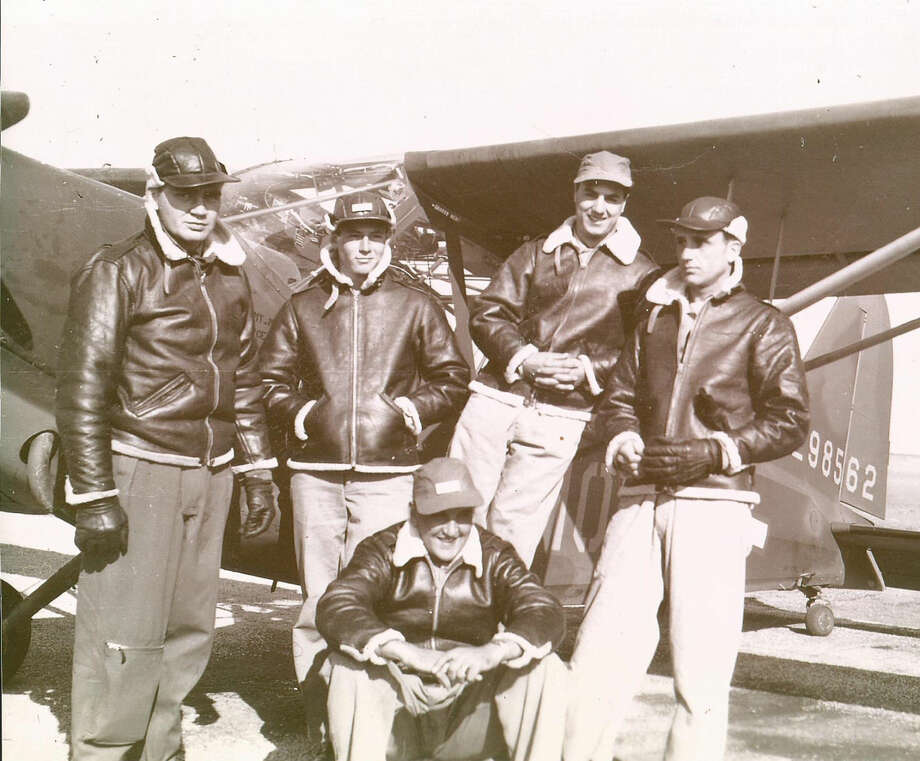 This photograph from February 1943 shows a group pilots during a time when Leighton Maggard was an instructor pilot at Finney Field. Maggard is shown at left and Jay McPherson at right.