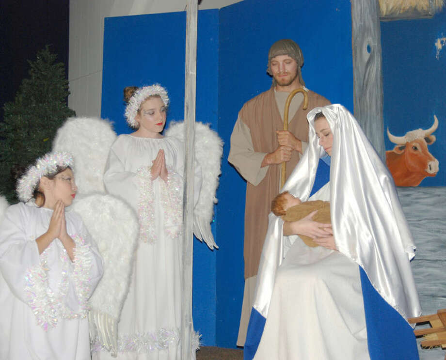 im Steiert/Courtesy Photo Angels gather around the birth site of Jesus in this scene from the Nazareth Christmas Pageant. This year marks the 20th staging of the Pageant since 1972 with performances at 7 p.m. Dec. 20 and 21 at Holy Family Catholic Church in Nazareth. Kyle and Kate Birkenfeld portray Joseph and Mary this year in a production that is faithful to the 1972 original.