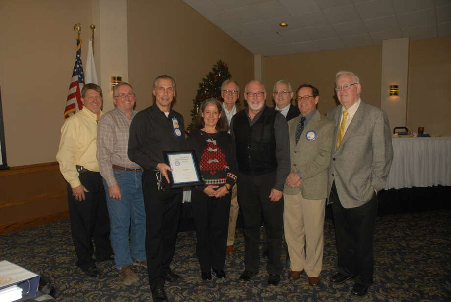 Members of Plainview's Rotary Club were honored with the RI Significant Achievement Award this week for their program rewarding PISD students with perfect attendance. Pictured above are Rotary members David Kopp, Steve Long, Ted Baker, Diana Anderson, J.B. Roberts, PISD Superintendent Dr. Rocky Kirk, Stan Demerritt, Dr. Michael Graves, and past Rotary District Governor Jim Cole. Photo: Homer Marquez/Plainview Herald