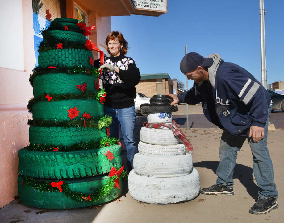 Dee Dee Ozborn and Jason Honeycutt used old tires to create decorations outside Cindy's County Quilt Shoppe, 633 Ash, including a 6 1/2-foot Christmas tree and a 4-foot snowman.