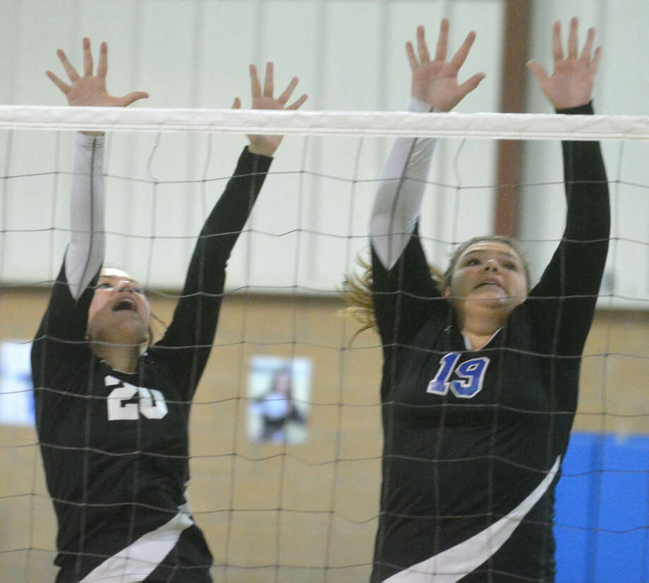 Plainview Christian Academy volleyball players Abbey Maresca (left) and Shayla Ross (right) go up for a block during the Lady Eagles' bi-district victory last week. PCA will go against Dallas Lakehill Prep in the regional semifinals Friday in Wichita Falls. Photo: Skip Leon/Plainview Herald